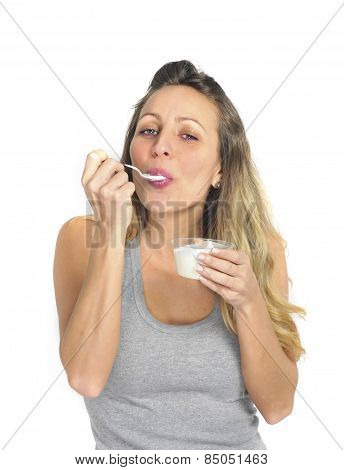 Young Sexy And Attractive Blond Girl With Spoon Eating Natural Cream Yogurt In Diet Healthy Nutritio