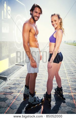 Fit couple rollerblading together on the promenade against fitness interface