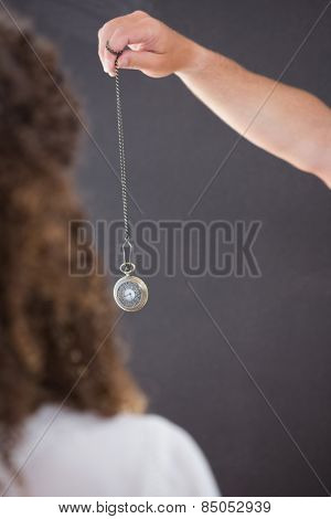 Woman being hypnotized with pendulum