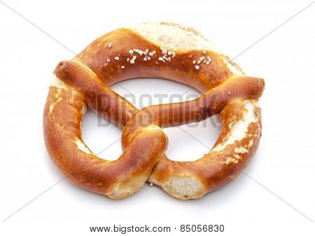 Freshly baked salted lye pretzel. All on white background.