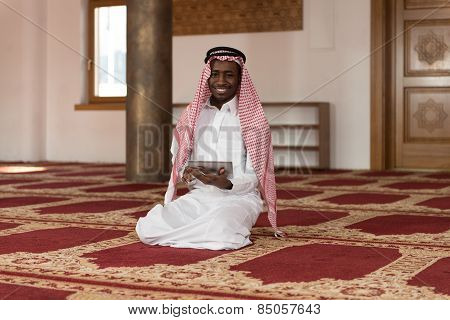 Handsome Middle Eastern Man Using A Touchpad