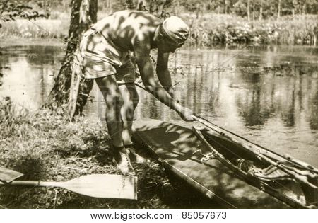 Vintage photo of young man during a canoe trip  (1960's)