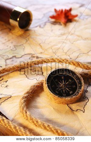 Marine still life with world map on wooden table background