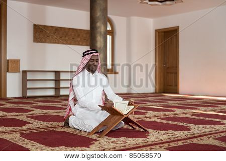 Black Businessman Reading The Koran