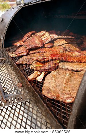 Slabs Of Ribs Cook On Grill At Barbeque Festival