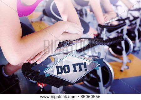 The word do it! and spin class working out in a row against badge