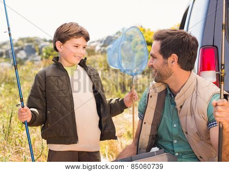 Father and son on a fishing trip on a sunny day