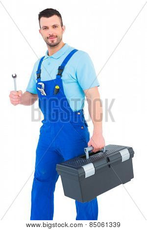 Repairman with toolbox and spanner on white background