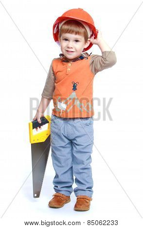 funny little boy in the construction helmet holding a hacksaw