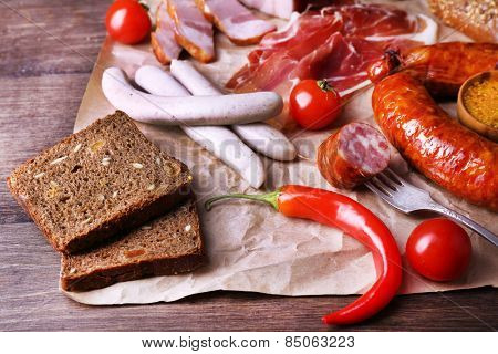 Assortment of deli meats on parchment, closeup