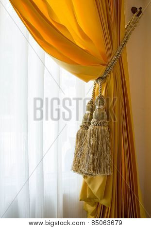 Curtain with curtain tieback at window