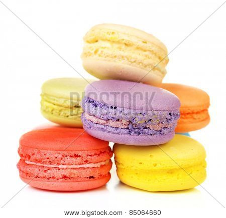 Tasty colorful macaroons isolated on white