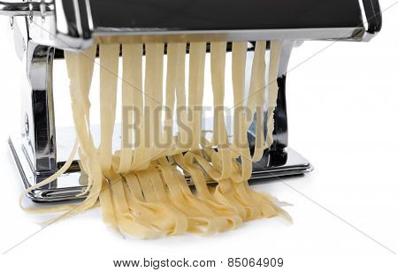 Metal pasta maker machine with dough isolated on white