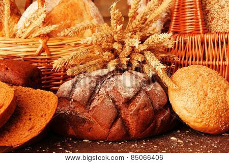 Different bread with ears in basket close up