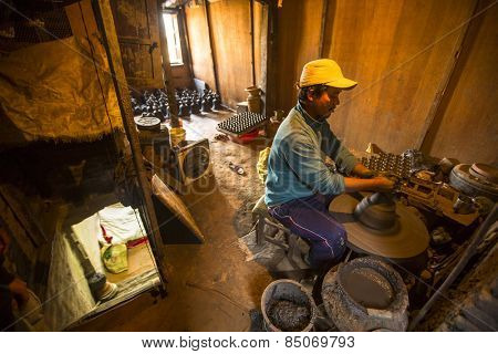 BHAKTAPUR, NEPAL - CIRCA DEC, 2013: Unidentified Nepalese man working in the his pottery workshop. More 100 cultural groups have created an image Bhaktapur as Capital of Nepal Arts.