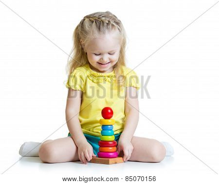 kid girl playing with pyramid toy isolated