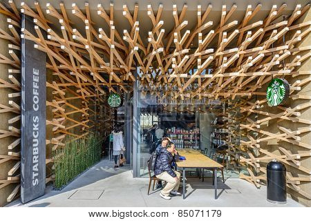 DAZAIFU, JAPAN - FEBRUARY 9, 2013: The unique Starbucks of Dazaifu. The design reflects the neighborhoods traditional roots while capturing the modern energy of the tourist destination.