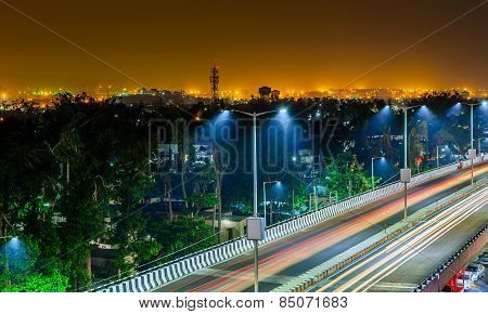 Night Freeway With Car Traffic And Lights trails