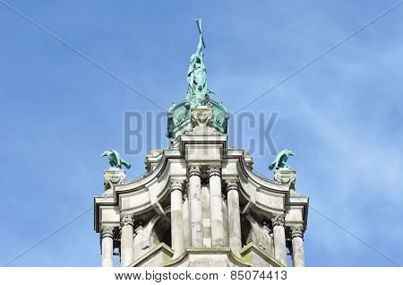 Top of victorian town hall tower depicting St Helena