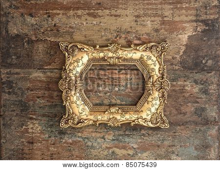 Baroque Golden Frame On Wooden Background. Grunge Texture