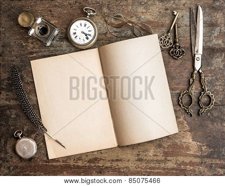 Open Diary Book And Antique Writing Tools On Wooden Background