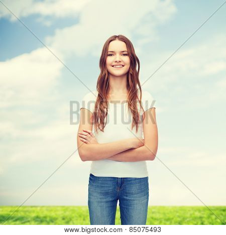 t-shirt design concept - smiling teenager in blank white t-shirt with crossed arms
