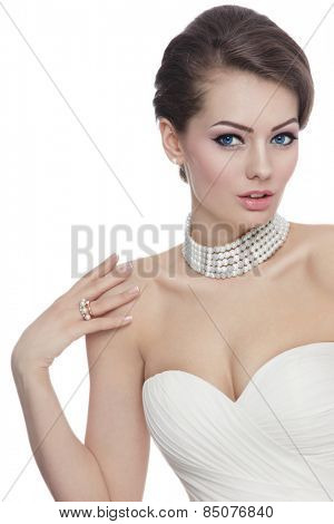 Young beautiful slim bride with stylish make-up and hairdo over white background with copy space