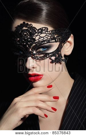 Portrait of young beautiful stylish woman in black lacy mask