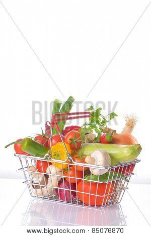 Assortment of fresh vegetables in metal basket