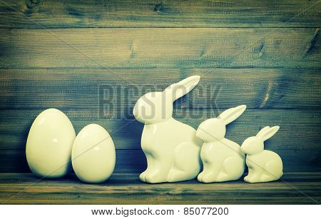 Easter Bunny Family And White Ceramic Eggs. Vintage Easter Decoration