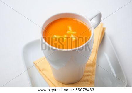 Cup of healthy pumpkin soup.