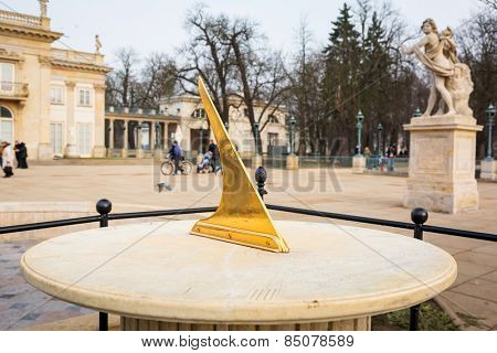 Ancient sun clock in Lazienki Park (Royal Baths Park), Warsaw, Poland