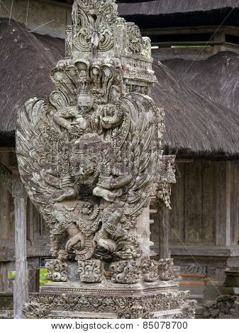 Ancient Balinese statue at a temple in Bali, Indonesia