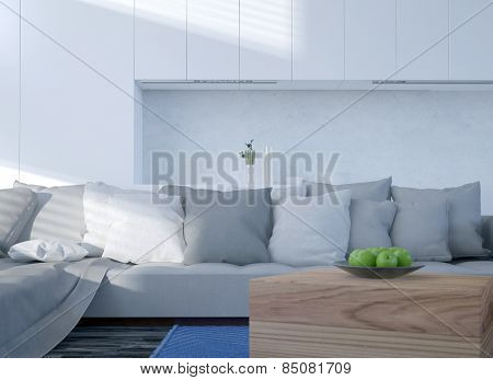 Comfortable upholstered grey couch with cushions in front of a recessed white wall with a bowl of fresh green apples in the foreground. 3d Rendering.