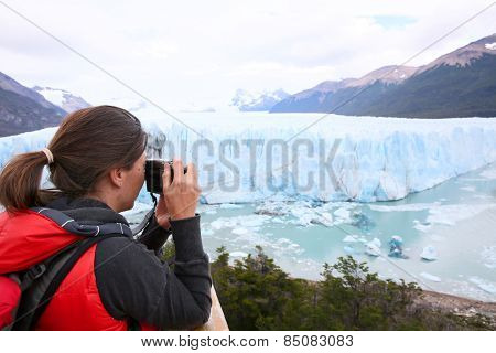Tourist taking picture of Perito Moreno Glacier