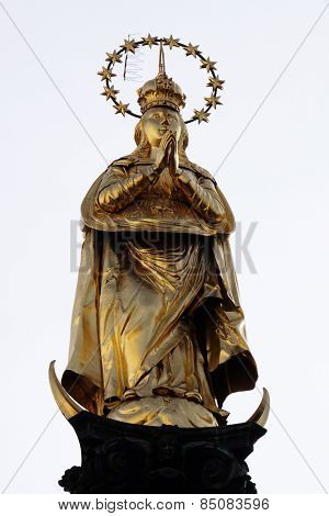 GRAZ, AUSTRIA - JANUARY 10, 2015: Gilded statue of Virgin Mary in Graz, Austria on January 10, 2015.