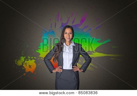 Confident Young Office Girl in Front a Creative Color Mixture Background on Gray Gradient.
