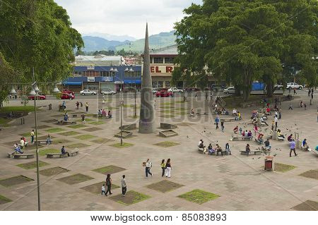 People walk by the Central square in Carago, Costa Rica.