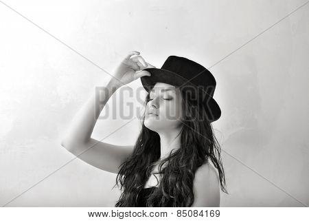 portrait of attractive girl in hat. Studio shot
