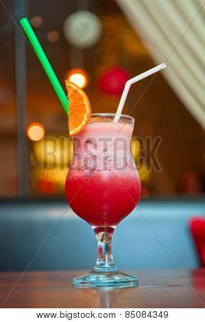 berry milkshake with orange fruit