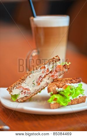 Sandwich with cheese and salmon and vegetables