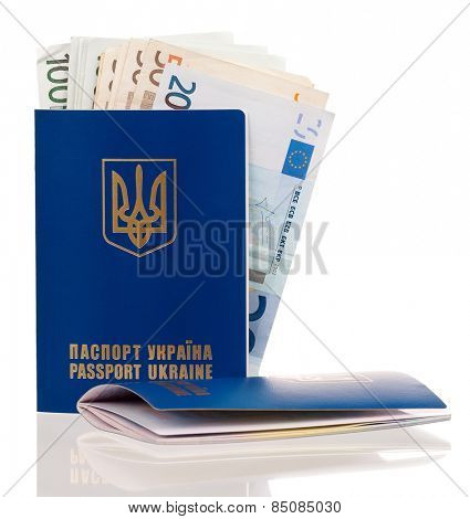 Two international Ukrainian passport with Euro banknotes isolated on background