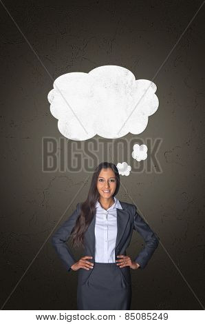 Confident Young Businesswoman with White Blank Speech Bubble Above her on Abstract Gray Gradient Background.