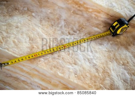 Measure Tape On Mineral Wool