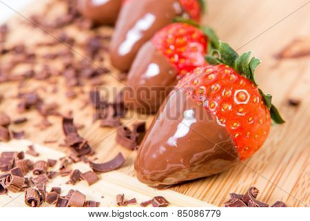 Chocolate Dipped Strawberries, Chocolate Pieces Around Him.