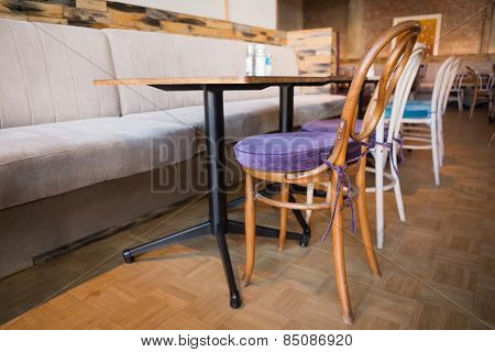 Stylish coffee shop with tables and chairs at the bakery