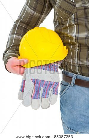Manual worker holding helmet and gloves on white background