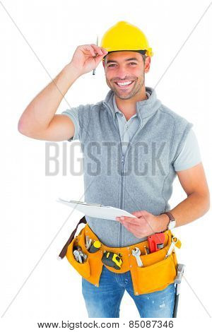 Portrait of smiling manual worker holding clipboard over white background