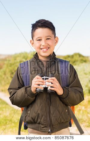 Little boy hiking in the mountains on a sunny day