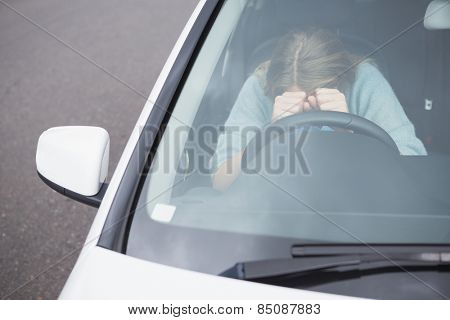 Young woman experiencing rage in her car